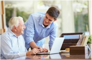 Picture of two men working on a laptop